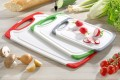 Chopping board Star made of white plastic with  green edge and handle Dimensions: 31.6 x 19.6 x 0.9 cm
